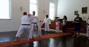Slam, teaching a technique to a karate student