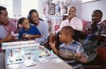 family having fun playing Monopoly